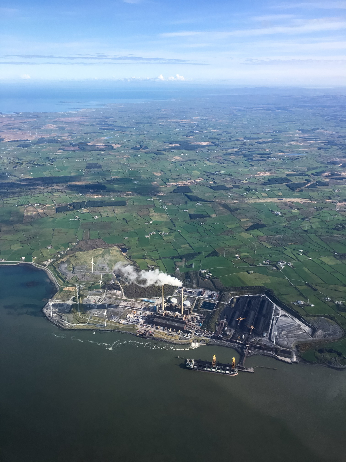 Ireland-0002-Powerplant with a HUGE amount of coal piled up in the lower right. Notice the new windmills installed right next to it.